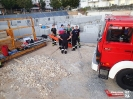 Übung der Absturzsicherung auf einer Baustelle im Heidfeld._16